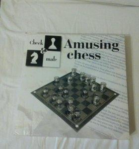 Настольная игра шахматная доска и рюмки.