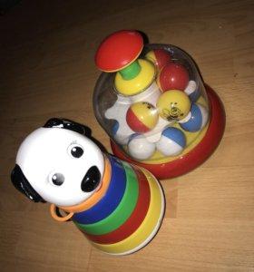 Две игрушки юла и неваляшка