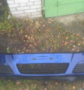 Передний бампер Opel Astra H дорест с птф
