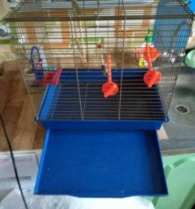 Клетка с кормушкой паилкой и игрушками