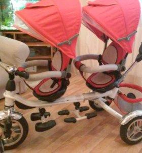 Велосипед трехколесный для двух детей