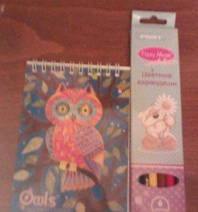 Блокнот и карандаши цветные