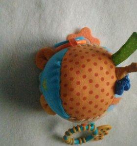 Развавающая игрушка-погремушка