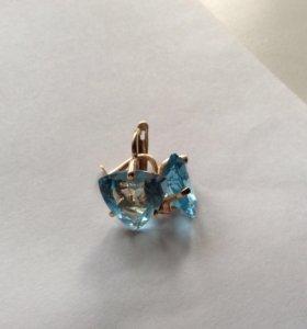Золотые серьги с голубыми топазами