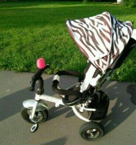 Велосипед-коляска зебра