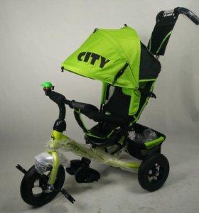 Детский велосипед  с  ручкой 10на8 надув.зелен