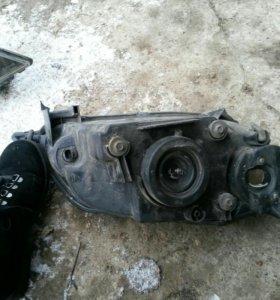 Фары Mazda demio
