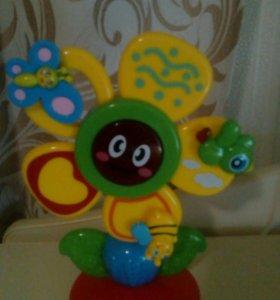Музыкальный цветок на присоске.Обучаюшая игрушка!
