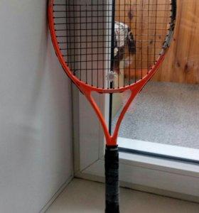 Ракетка для тенниса.