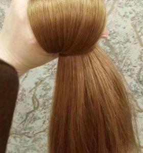 Волосы на заколках натуральные.