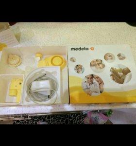 Молокоотсос Medela Mini Electric электрический