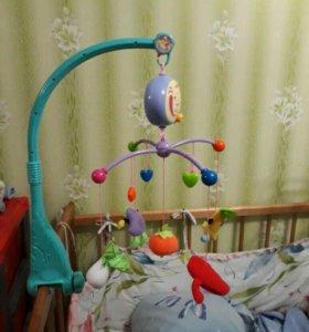 Детская музыкальная игрушка на кровать