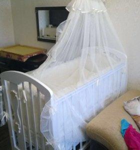 Детская кроватка с поперечным маятником