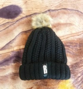 Продам теплую шапку
