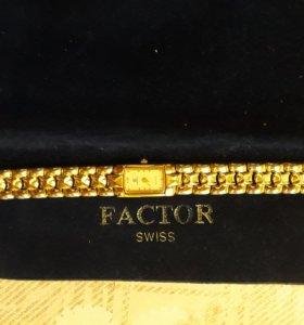 Позолоченные часы 32карат золота.