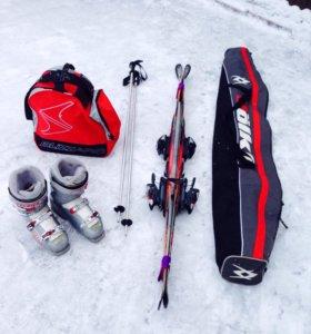 Горные лыжи, ботинки, палки, сумка, чехол.