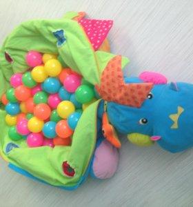 Развивающая игрушка Малыш динозаврик с шариками