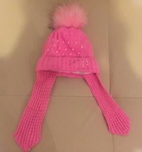 Розовая шапка на зиму с помпоном