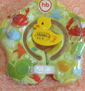 Круг для купания и термометр