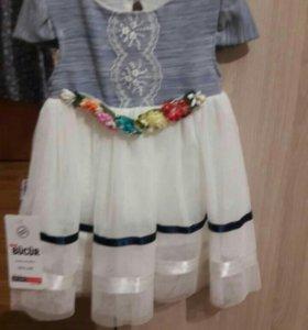Платье новое, на 6 месяцев.