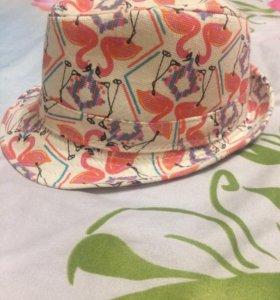 Две зимние шапки и кепка