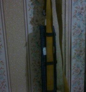 Удерживающие устройство с ленточным стропом