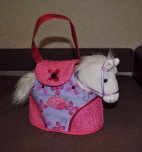 Лошадка в сумке.