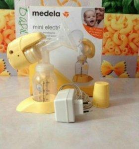 Новый электрический молокоотсос Медела мини электр