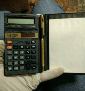 Новый калькулятор с блокнотом и ручкой