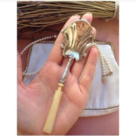 Антикварная ложка из серебра с костью