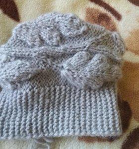 Теплая вязанная женская шапка