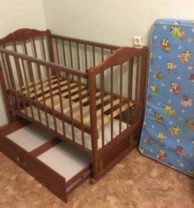 Кроватка с маятниковым механизмом