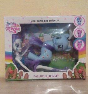 Пони с куклой