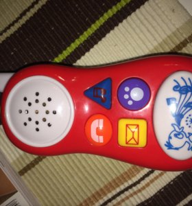 Игрушка музыкальный телефон