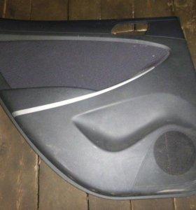 Обшивка двери Hyundai Solaris