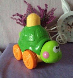 Игрушка каталка со звуком музыкальная черепаха
