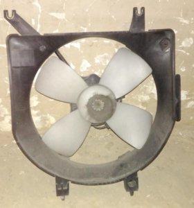 Диффузор радиатора мазда демио 1996-1999
