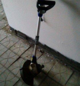 Электрическая газонокосилка +катушка-удлинитель.