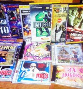 50 CD и DVD дисков с фильмами, музыкой и играми