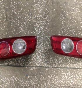 фонарь в крышку багажника Mazda Demio