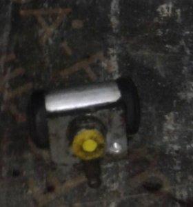 Рабочий тормозной цилиндр задней подвески Логан
