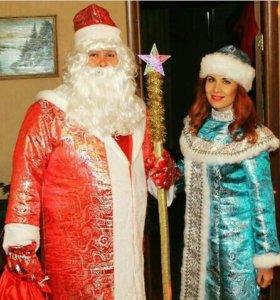Дед Мороз и Снегурочка с щенком сибирской хаски