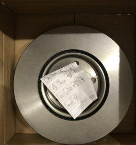 Передние тормозные диски и колодки на Опель