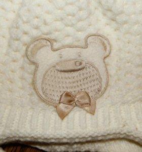 Милая зимняя шапка