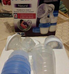 Молокоотсос с контейнерами для хранения молока