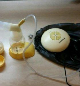 Электрический молокоотсос Medela и нагреватель
