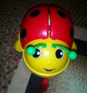 Игрушка на колесиках