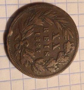 Старинная португальская монета 1883 года.