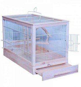 Деревянная клетка для птиц.