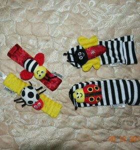 Погремушки носочки и браслетики Lamaze